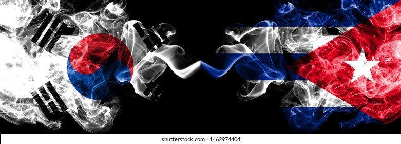 South Korea vs Cuba, Cuban smoky mystic flags placed side by side. Thick colored silky abstract smoke flags of South Korean and Cuba, Cuban