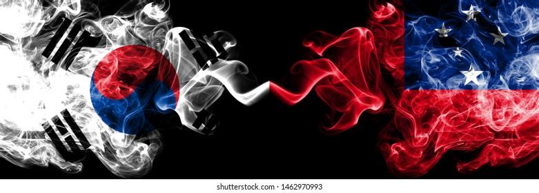 South Korea vs Samoa, Samoan smoky mystic flags placed side by side. Thick colored silky abstract smoke flags of South Korean and Samoa, Samoan