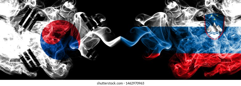South Korea vs Slovenia, Slovenian smoky mystic flags placed side by side. Thick colored silky abstract smoke flags of South Korean and Slovenia, Slovenian