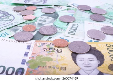 South Korean bank notes and coins background