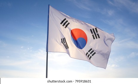The South Korean Flag with Blue Skies.