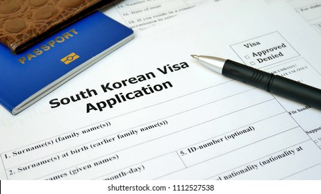 South Korean Visa application form with passport and pen. Document with passport, apply and permission for foreigner country