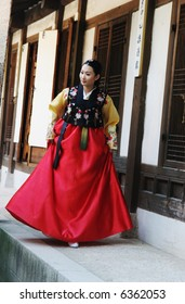 South Korean woman in traditional dress - travel and tourism.