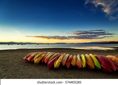 SOUTH LAKE TAHOE, CA - OCTOBER 7, 2015: Kayaks on the beach at South Lake Tahoe at sunset.
