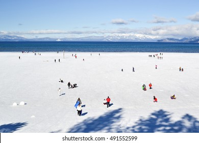 South Lake Tahoe, California, USA, 10 January 2016. Unidentified crowd enjoy the frozen waters of Lake Tahoe in the winter. Lake Tahoe is a winter tourist destination mostly due to winter sports