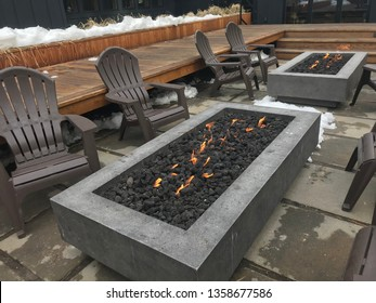South Lake Tahoe, California/USA - March 12, 2019: A gas firepit with flames and Andirondack chairs welcomes skiers back from the snow in South Lake Tahoe