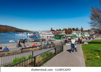 South Lakeland, UK - April 2018: Bowness Pier with boats for hire and tourist cruises at Bowness-on-Windermere, a small tourist resort town on the banks of Windermere in Lake District, England