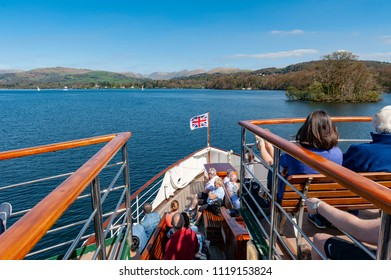 South Lakeland, UK - April 2018: Tourists enjoying boat cruise at Lake Windermere from Bowness-on-Windermere to Ambleside on summer day in Lake District, England