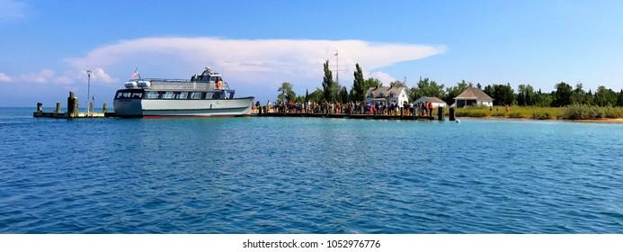 South Manitou Island, Michigan, USA - July 31, 2017: Passengers waiting to board the Mishe-Mokwa to return to Leland from South Manitou Island.
