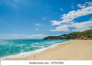 South Mediterranean coast of Sardinia Island, Italy. Beautiful blue Mediterranean sea and sky. Famous beaches of white sand, favorite touristic destination.