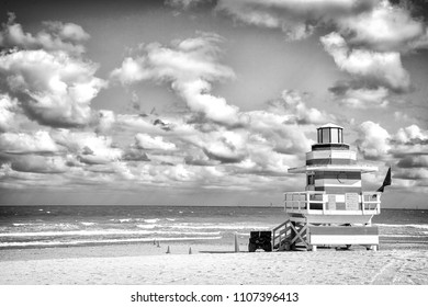 South miami beach. Lifeguard tower for rescue baywatch on south beach in Miami, USA. Red and white wooden house on sea shore background. Summer vacation resort. Public guarding and safety concept