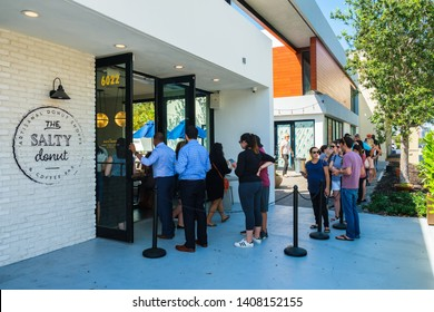 South Miami, Florida USA - May 23, 2019: Patrons waiting in line at the popular Salty Donut, a newly opened gourmet donut shop in the downtown area.