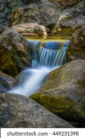 The South Mountains are an isolated, majestic and rugged mountain range near Morganton, North Carolina. These mountains include 10,000 acres and is a great park with many waterfalls along the creek.