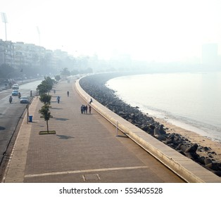 South Mumbai's (India) elite Marine Drive stretch gradually disappearing in early morning mist. This stretch runs adjascent to Arabian sea and has prominently heritage residential structures.