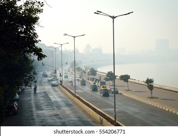 South Mumbai's (India) elite Marine Drive stretch gradually disappearing in early morning mist. This stretch runs along Arabian sea and has prominently heritage residential structures. Copy space.