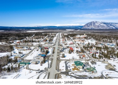 South to North view of the main street in Haines Junction in the Yukon taken from a drone on a sunny day in spring.