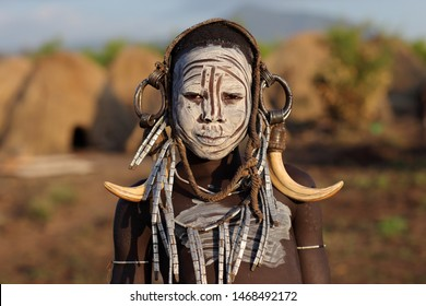 SOUTH OMO - ETHIOPIA - JANUARY 4, 2017: Unidentified Mursi tribal boy in the Mago National Park, Lower Omo Valley