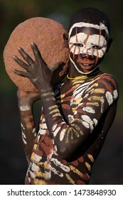 SOUTH OMO - ETHIOPIA - OCTOBER 16, 2017: Unidentified young Suri boy at a ceremony in Lower Omo Valley