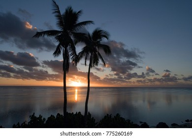 South Pacific sunset over a tropical lagoon in the Cook Islands in the South Pacific