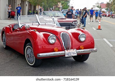 SOUTH PASADENA/CALIFORNIA - SEPT. 17, 2017: Classic Jaguar roadster departs from a gathering of classic car enthusiasts in South Pasadena, California USA
