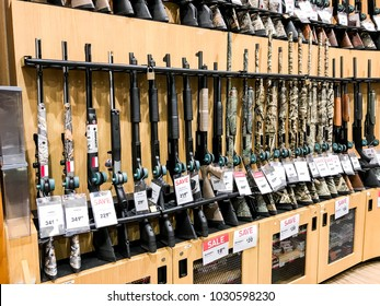 South Plainfield, NJ, 02/17/2018: Hunting rifles stand on a shelf in a Dick's Sporting Goods store.