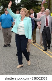 SOUTH PLAINFIELD,NJ-AUGUST 9,2016:Kim Guadagno (center) the first Lieutenant Governor of New Jersey waves to parade-goers during the South Plainfield Labor Day Parade held in So.Plainfield,New Jersey.