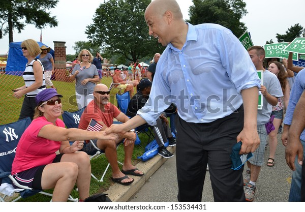 SOUTH PLAINFIELD,NJ-SEPTEMBER 2: Newark NJ Mayor and U.S. Senate candidate Cory Booker greets a parade-goer during the 56th Annual Labor Day Parade on September 2,2013 in South Plainfield,N.J.