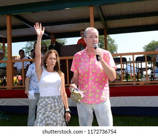 SOUTH PLAINFIELD,NJ/US - SEPTEMBER 3,2018: New Jersey Governor Phil Murphy (R) and First Lady Tammy Murphy greet parade-goers during the 61st Annual Labor Day Parade in south Plainfield,NJ/US.