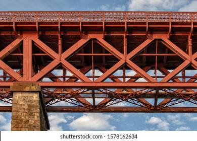 South Queensferry, Lothian, Scotland - August 3, 2019: The Forth Bridge is a cantilever railway bridge across the Firth of Forth and and is a UNESCO World Heritage Site