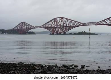 South Queensferry / Scotland - 09.03.2019: View to the Forth Bridge in cloudy rainy day