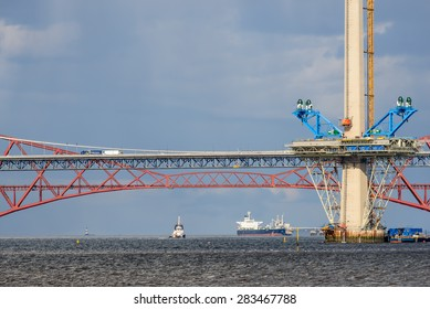 SOUTH QUEENSFERRY, SCOTLAND, UK - MAY 29, 2015: Construction of The Queensferry Crossing a new road bridge built close to the Forth Road Bridge and Forth Bridge spanning the River Forth in Scotland.