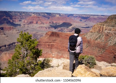 At the south rim of Grand Canyon torist is  checking out canyon walls buaity