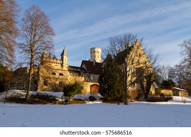 South side of castle Lichtenstein in Swabia, Germany, bathed in stunningly beautiful early morning light on a cold winter's day.