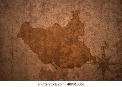south sudan map on a old vintage crack paper background