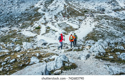 South Tirol, Italy- October 10, 2017. Portrait of a group of tourists with backpacks climbing a mountain