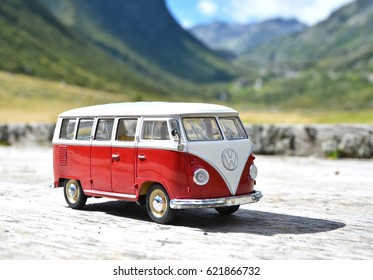 SOUTH TYROL, ITALY - JULY 27, 2016: Miniature VW Bulli 1962 on the rural road. The cult car of the Hippie generation and it remained the status vehicle of campers.