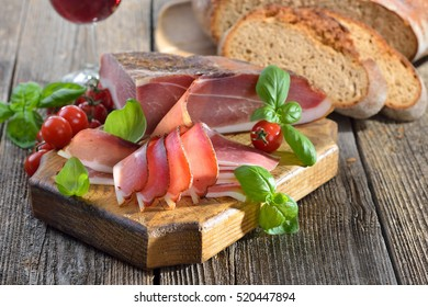 South Tyrolean bacon with fresh stone oven baked bread and local red wine