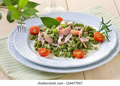 South Tyrolean spinach spaetzle with parmesan cream sauce and strips of ham