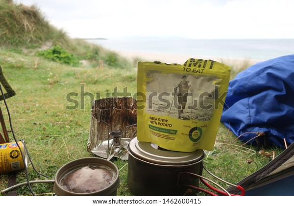South uist. Outer Hebrides. Scotland. June. 7. 2019. Dehydrated Food Cooking pot view from tent Wild camping on sand dunes