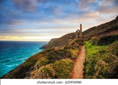 South West Coast Path as it approaches the ruins of the Wheal Coates mining engine house near St Agnes in Cornwall.