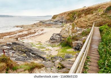 South west coastal path, bridge across secluded cove at St Antony's head, Roseland Penisula, Cornwall,