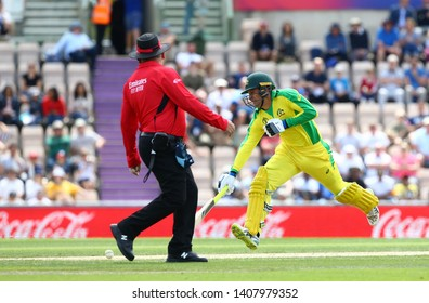 SOUTHAMPTON, ENGLAND. 25 MAY 2019:  Marcus Stoinis of Australia runs a single as Umpire Marais Erasmus takes evasive action during the England v Australia, ICC Cricket World Cup warm up match,
