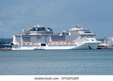 Southampton, England, UK. 2021. Cruise ship MSC Virtuosa berthed and seen from Hythe on Southampton Water Southampton, UK