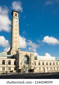 Southampton, England, UK - February 16, 2014: Sun shines on the art deco facade and clock tower of the west wing of Southampton Civic Centre.