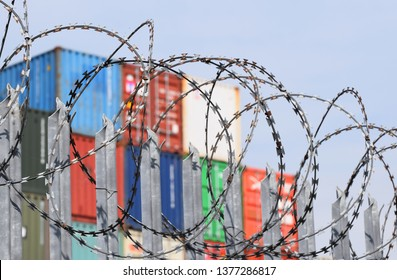 Southampton, Hampshire. Apr 22 2019.  freight shipping containers behind a fence and barbed razor wire at one of the UK's  business ports. A good metaphor for trade barriers, trade wars, hard borders.