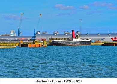 Southampton, Hampshire / England - 10/12/2017: Old Calshot Tug/Tender boat (launched 1929) moored adjacent to Ocean Terminal Southampton.Formerly tug & tender to many great Trans-Atlantic Liners.