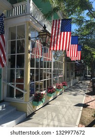 Southampton, NY, USA June 27, 2017 American flags hang from a store on a sunny summer's day in the downtown Southampton, New York