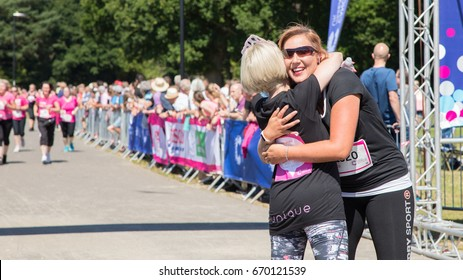 Southampton, Uk - 2 July 2017: Celebration at the finish line of Race for Life. This annual race is run by women and children to raise money for Cancer Research.