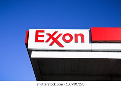 Southaven, MS/USA - October 24 2019: Partial Exxon gas station roof and sign on a clear day with blue skies. Exxon Mobil is an American gas and oil company.