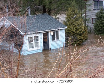 SOUTHBURY, CONNECTICUT - MARCH 7: Flooding cottage along the Pomperaug River on March 7, 2011 in Southbury, CT. The neighborhood is being evacuated due to the vast rainfall and the rising river.